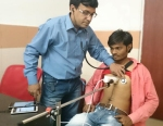 Partho-and-young-patient-med-300pix-high